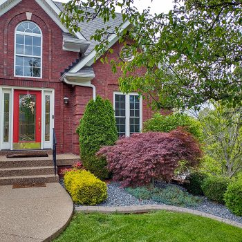 Exterior of red brick home for home tour