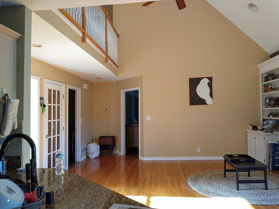 living room of our fixer upper facing towards primary bedroom and laundry room